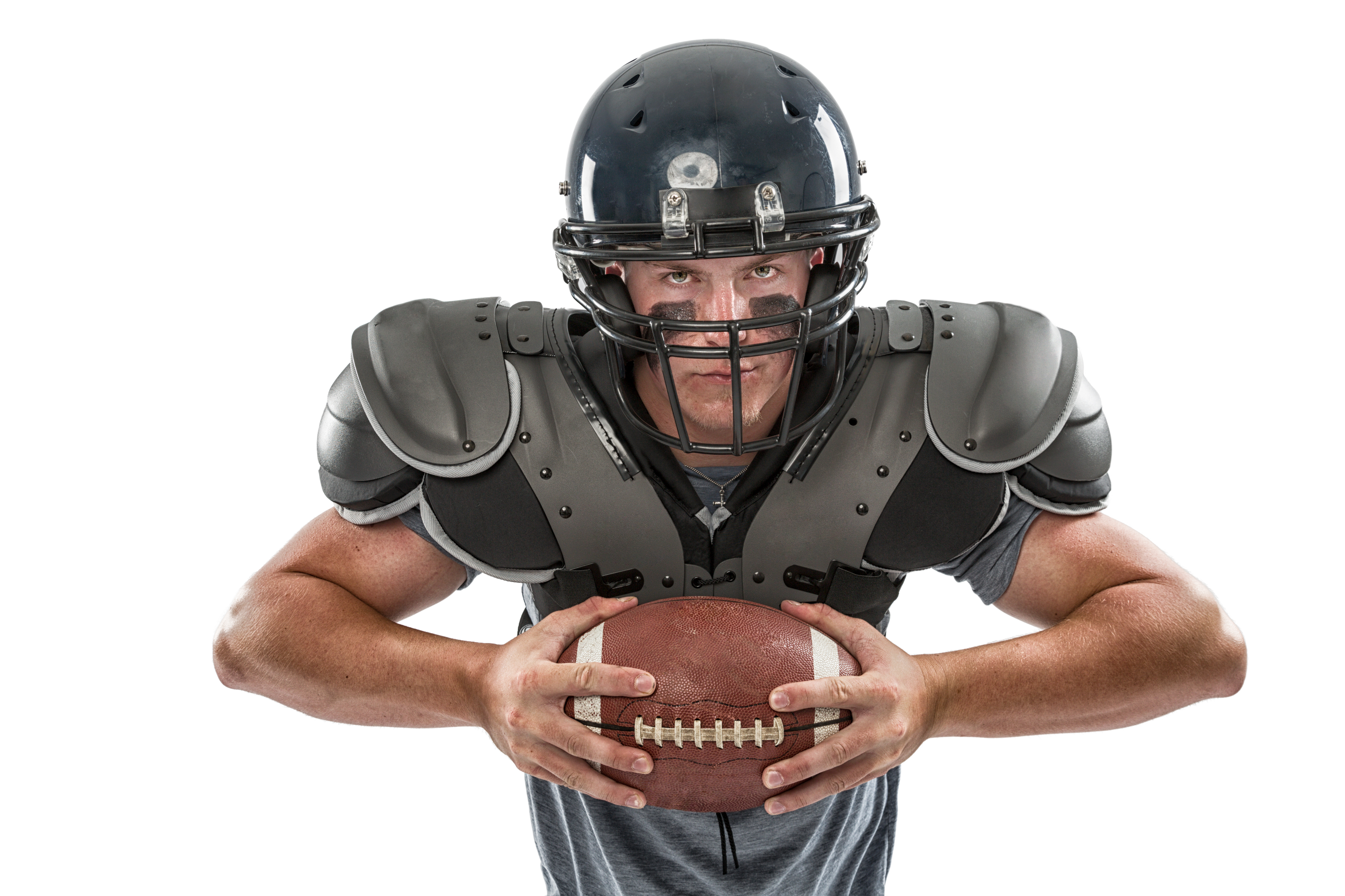 Football player in pads, helmet, football_iStock-155381947